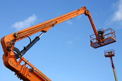 Cherry Picker Lifts. Two High Level Mechanical Cherry Picker Lifts royalty free stock photography