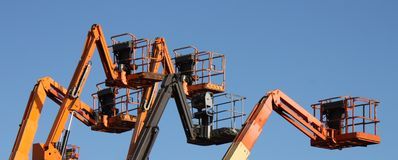 Cherry Picker Lifts. A Group of Mechanical Cherry Picker Lifts stock photo