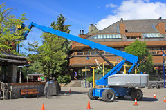 Cherry Picker. Working in Whistler, Canada royalty free stock photography