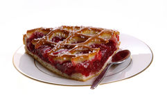 Cherry pie. One piece of cherry pie on plate with spoon on the side Stock Photos