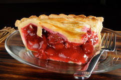 Cherry pie. A rich fresh slice of cherry pie with a black background stock photography