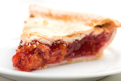 Cherry Pie. Fresh slice of cherry pie on white royalty free stock images