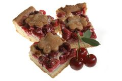 Cherry pie. Pieces of a cherry pie and fresh cherries royalty free stock photos