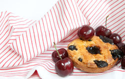 Cherry pie. Cherries and homebaked cherry pie on a striped cloth stock photos