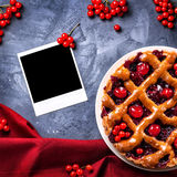 Cherry pie and blank photo Stock Image