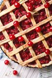 Cherry pie close up on the table. vertical top view Stock Photography