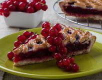 Cherry pie on green plate Stock Photos