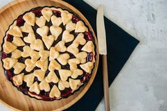Cherry pie with heart shape decorations. From flaky dough Stock Images