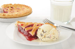 Cherry pie and ice crream stock images
