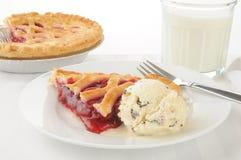 Cherry pie and ice crream Stock Images