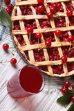 Cherry pie and juice close up on the table. vertical top view Stock Photo