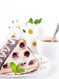 Cherry pie with mint and a cup of coffee, flowers Royalty Free Stock Photography