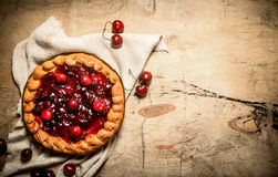 Cherry pie for old fabrics. Stock Photography