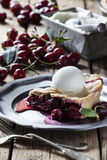 Cherry pie. Old-fashined cherry pie with ice-cream royalty free stock image