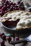 Cherry pie. Old-fashined cherry pie on wooden background stock photo
