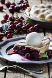 Cherry pie. Old-fashioned cherry pie with ice-cream royalty free stock photos