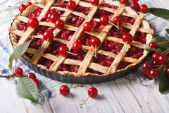 Cherry pie and ripe berries on the table. Horizontal Stock Photos