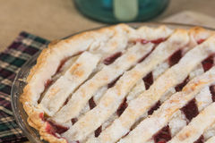 Cherry pie. In a rustic setting Royalty Free Stock Photography