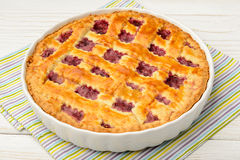 Cherry pie on white wooden table. Cherry pie on wooden table royalty free stock photo