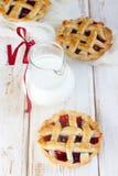 Cherry pies. Fresh cherry pies with lattice Stock Photography