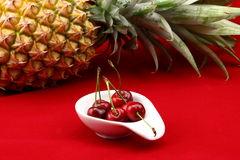Cherry and pineapple Royalty Free Stock Photography