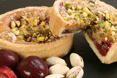 Cherry and pistachio tartlets Royalty Free Stock Images