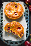 Cherry pistachio tarts. Summer table Stock Photo