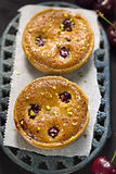 Cherry pistachio tarts. Summer table Royalty Free Stock Photo