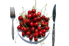 Cherry plate. Plate of cherries in the summer sun royalty free stock images