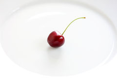 Cherry on plate Royalty Free Stock Photo