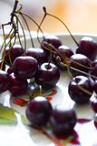 Cherry in the plate Royalty Free Stock Photo