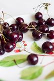Cherry in the plate Stock Images