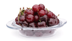 Cherry in plate. On white background Stock Photography