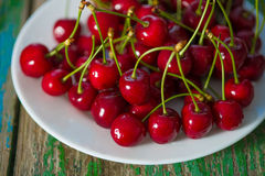 Cherry on plate on the table Stock Photography