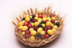 Cherry plums in a wooden basket Royalty Free Stock Images