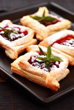 Cherry puff pastry. Delicious Cherry puff pastry with powdered sugar Stock Photo