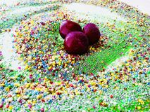 Cherry in purple glitter. royalty free stock photo