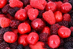 Cherry, Raspberry, Blackberry On Full Background Royalty Free Stock Photos