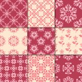 Cherry red and beige floral ornaments. Collection of seamless patterns Stock Images