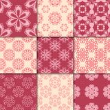 Cherry red and beige floral ornaments. Collection of seamless patterns Royalty Free Stock Photos