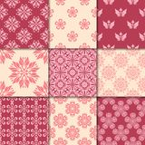 Cherry red and beige floral ornaments. Collection of seamless patterns Stock Photos