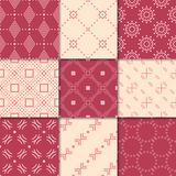 Cherry red and beige geometric ornaments. Collection of seamless patterns. For web, textile and wallpapers Stock Images