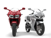 Cherry red and silver modern super sports bikes Royalty Free Stock Photos