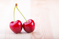 Cherry. Red cherry at the wooden table Stock Image