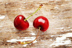 Cherry. Ripe cherry on wooden background Stock Photo