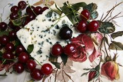 Cherry and roquefort cheese Stock Photos