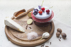 Cherry sauce with cheese brie, cherry and spice on wooden board Stock Images