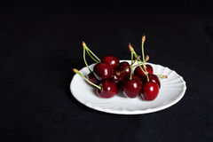 Cherry on a saucer Royalty Free Stock Photo