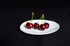 Cherry on a saucer Royalty Free Stock Photography