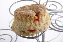 Cherry scone on a cake stand Royalty Free Stock Images
